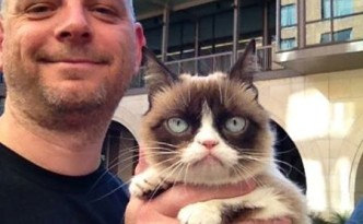 I let Grumpy Cat have her picture taken with me.