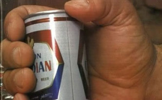 Andre the Giant holding a beer.